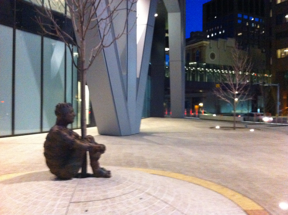 Alberta's Dream aka The Tree Hugger, sit all alone one the sidewalk/plaza on the back side of the Bow office tower.  The political message is obvious.
