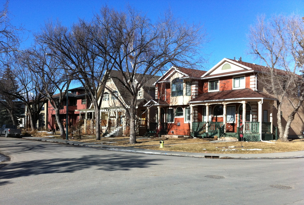 Across the street from the block with the original urban cottages is a row of new infills.  The contrast is wonderful as the new homes have more colour, more design variations and will keep the community thriving for another 50 years.  These new homes accommodate the needs of new families which means the parks, playgrounds and school yards are full of screaming children.