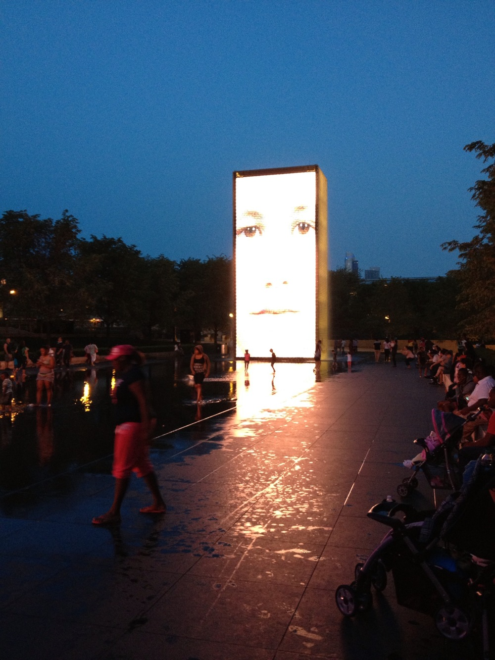 Another image of the Crown Fountain at night...it looks almost like a huge flame that lights up the wading pool.  It is just one big happy campfire in the middle of the city that you share with strangers.