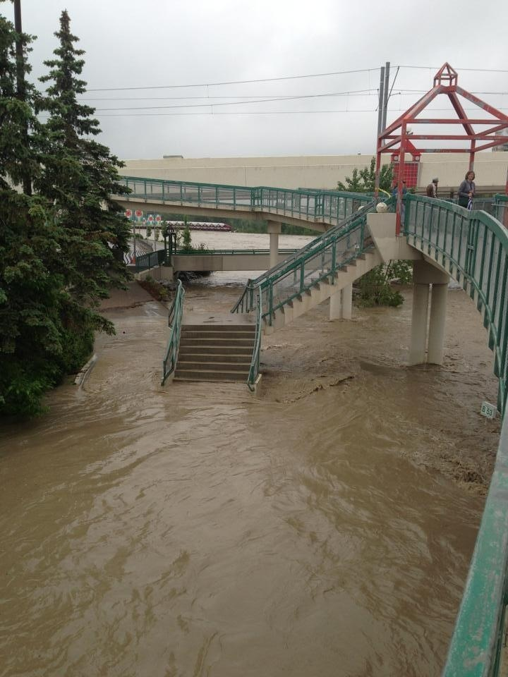 Access to one of the pedestrian/bike bridges over the Bow River from the northside to downtown flooded.  Normally thousands of Calgarians use these stairs and ramps.