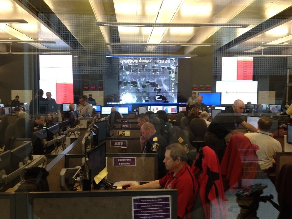 Inside Calgary's state of the art Emergency Operations Centre hundreds of professionals from various disciplines are implementing a coordinated emergency response. Some are working 20+ hour shifts.