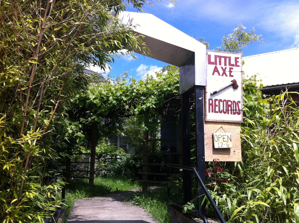 Little Axe Records is located just off Alberta Avenue but you could easily miss it as it is just a small cottage house that is hidden behind the garden.  It would be easy to dismiss, but for record hounds it is definitely a find.  Lots of listening stations and friendly knowledgeable staff.