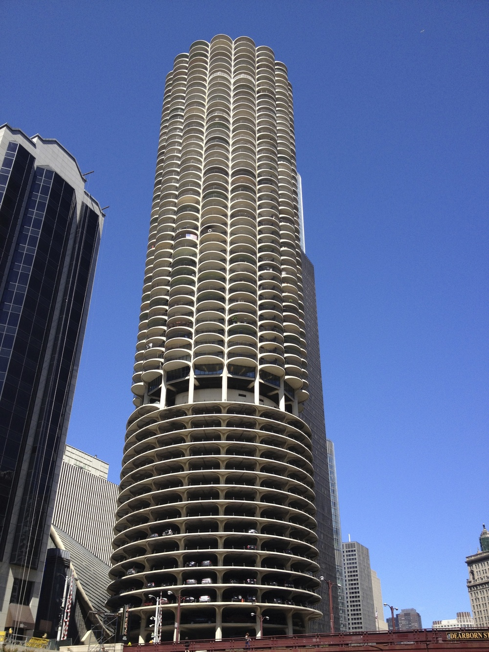 Marina City was completed in 1964.  Its corncob-like facade is a unique design that stands out immediately in the skyline.  At 65 floors the twin towers were the tallest residential buildings in the world when they were built. Note the bottom floors is actually a parking garage if you look closely you can see the cars.
