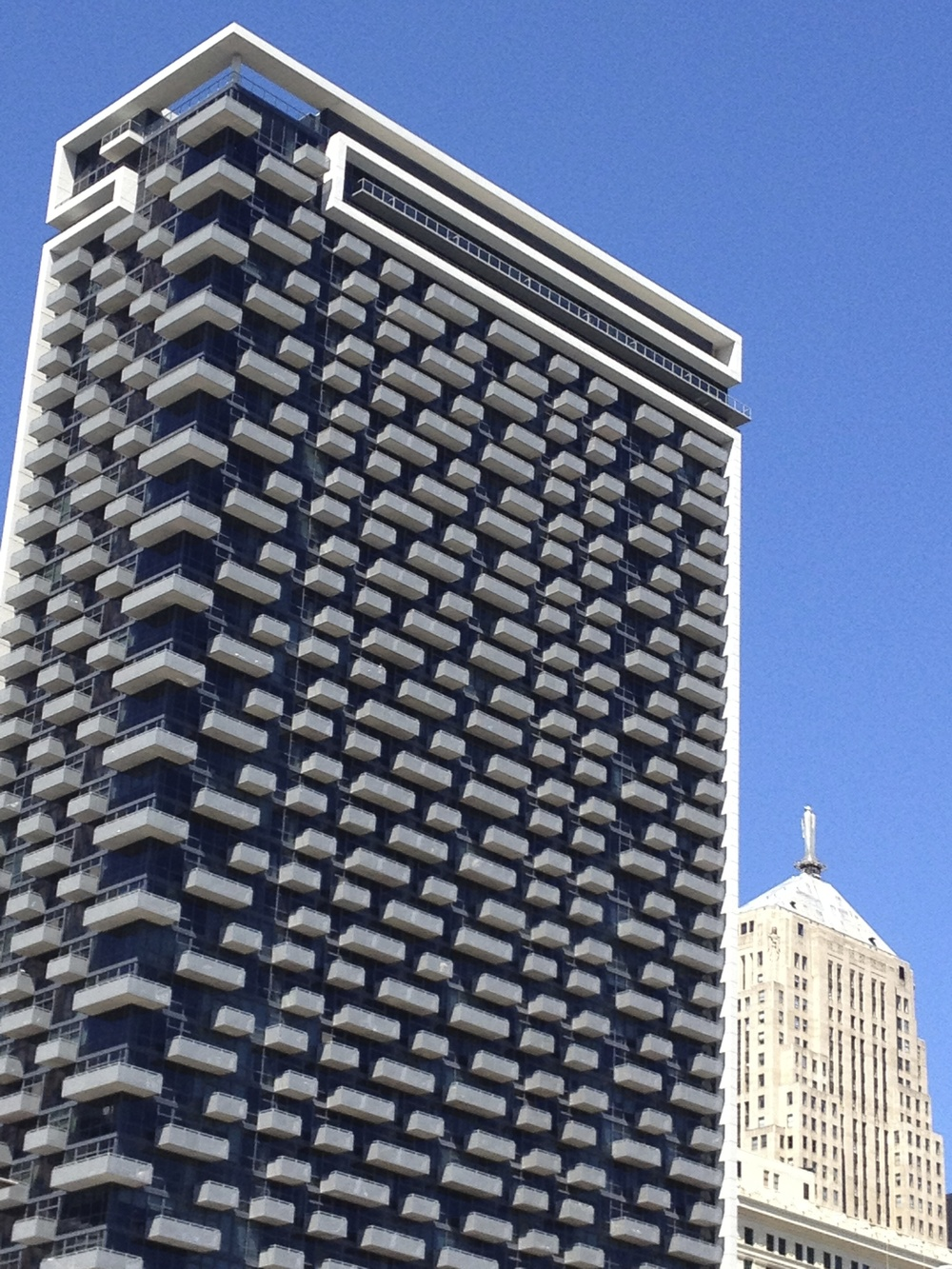 The CBD apartment building is another of Chicago's distinctive architectural gems.  In this case the pattern of different sized balconies creates a facade that is visually playful and exciting.