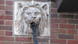 Although Calgary is known for its Western heritage, lions have played and continue to play a role as public art in Calgary. This lion's head is on the former Holy Angels School on Cliff Street.