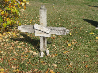 This small wooden cross marks a gravesite in St. Mary's Cemetery.