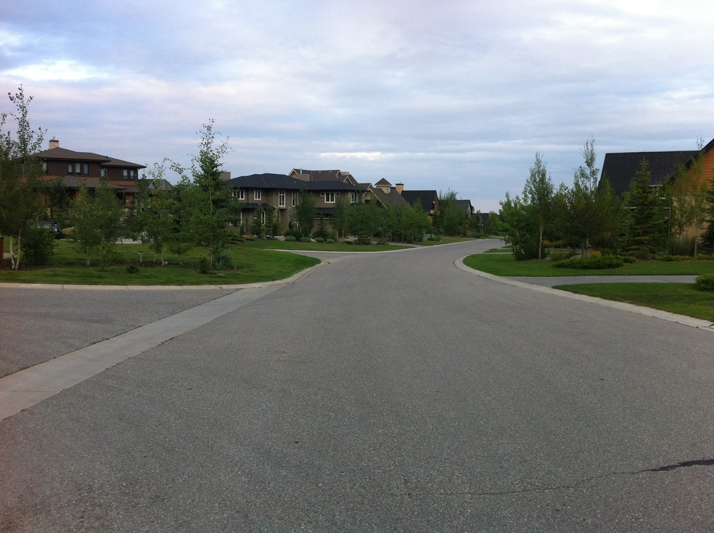 A sample street with no sidewalks, no cars and no people.