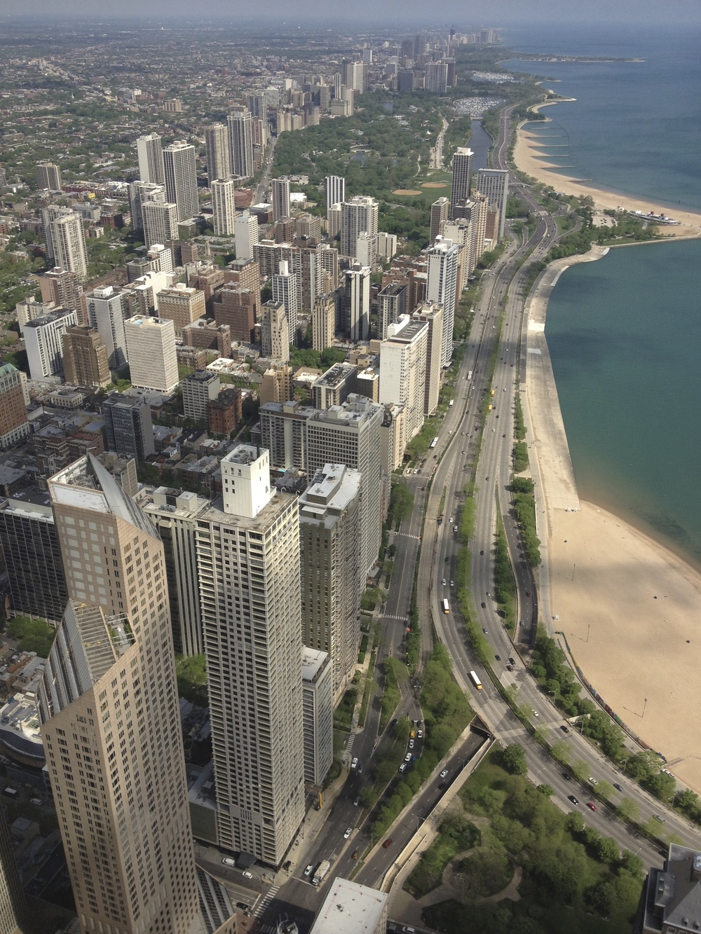 Aerial view of Chicago's beaches from the Hancock Building with Lincoln Park at the top.  Beach, park, zoo, farm and farmer's market makes living small easy in Lincoln Park or Gold Coast communities in Chicago.