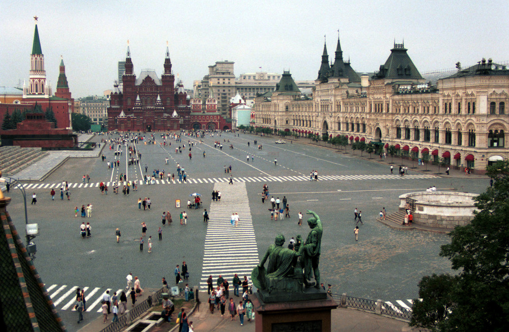 This is Red Square in Moscow which is just a large flat open space with buildings not roads on the edges.  It has good pedestrian traffic even when there is no programming.  There are no trees, no decorative design elements, just space.