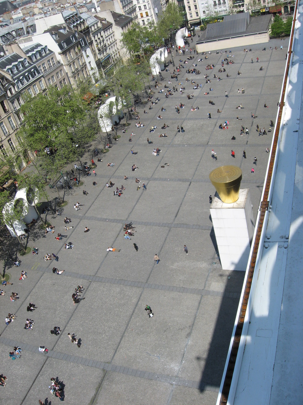 This is the plaza outside of Centre Pompidou in Paris. Again just a flat open space.There are some trees on the edge but they are deciduous which allow people to see into and out of the plaza.  One the best plaza activities is people watching - people attract people.