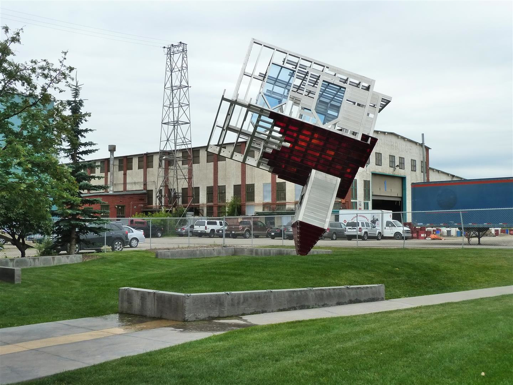 """Device to Root Out Evil"" was created by Dennis Oppenheim in 1997.  It is a compelling 6 meter tall glass, steel and aluminum sculpture on loan to the Glenbow Museum from Vancouver's Benefic Foundation."