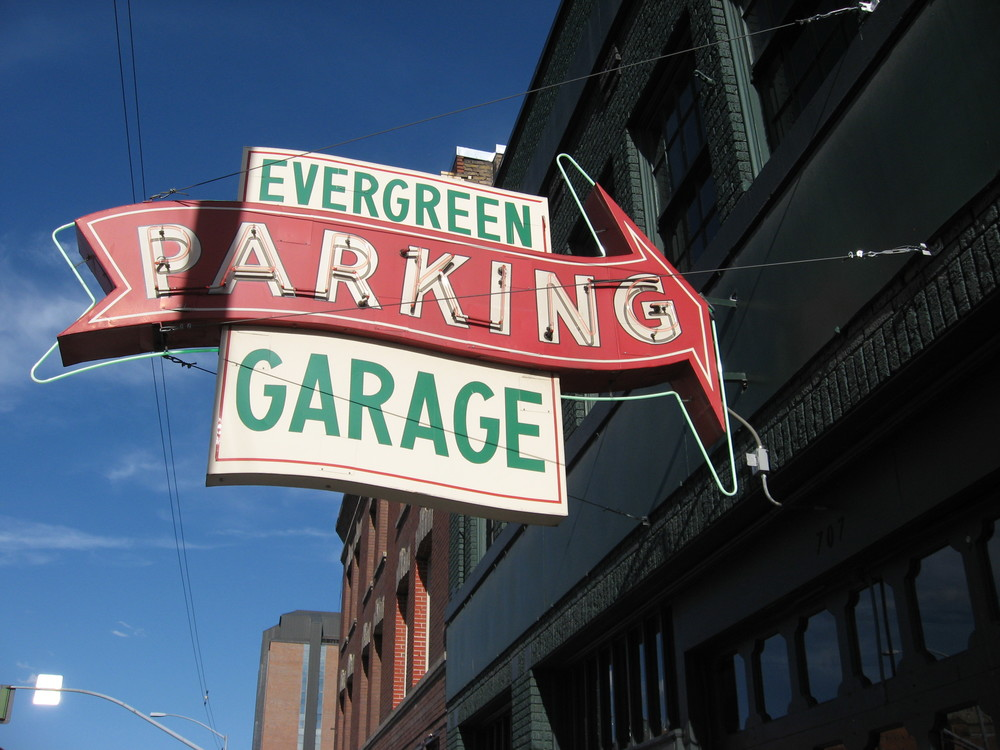 "Spokane has several vintage parkades with great neon signs at the entrance.  One has to wonder how this parking garage got the name ""Evergreen."" You would never associate a parkade today with the term evergreen."