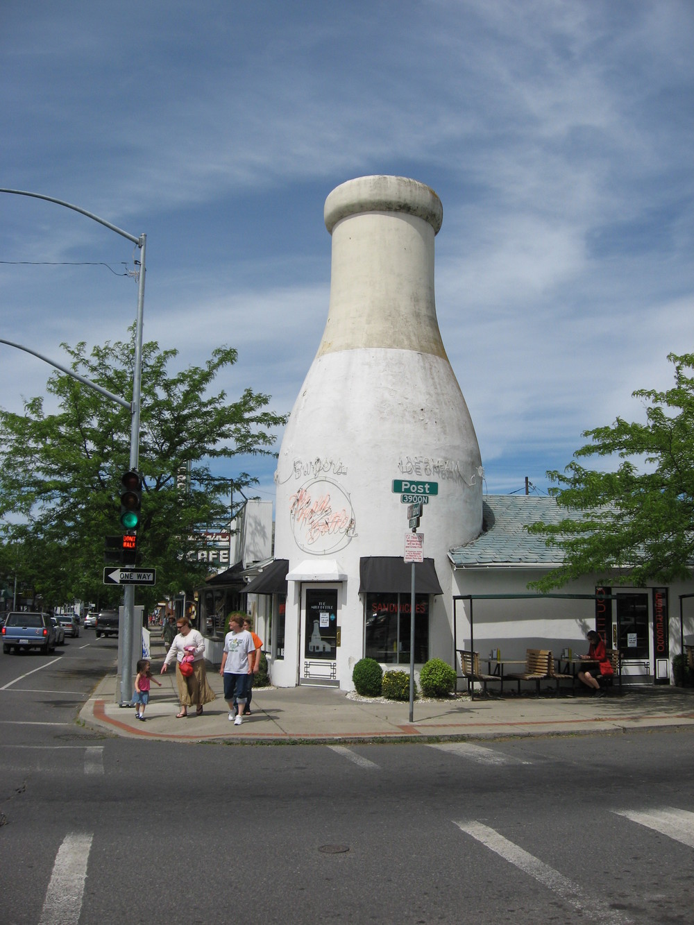 The  1935 Benewah Milk Bottle is the other iconic building in the Garland District.