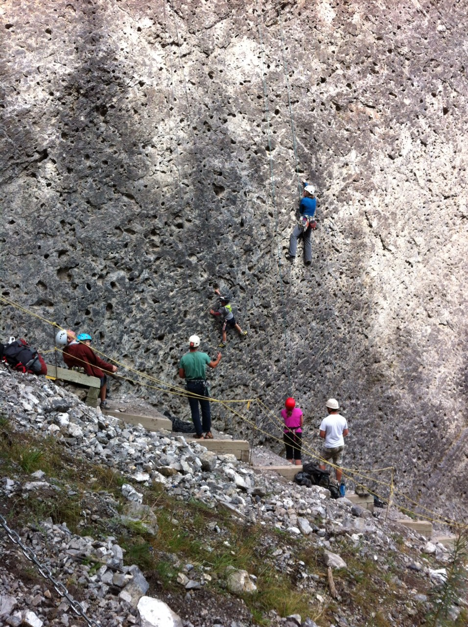 A group of rock climbers at the upper Grassi Lake.  This was just one of about five or six groups showing off their death defying skills.