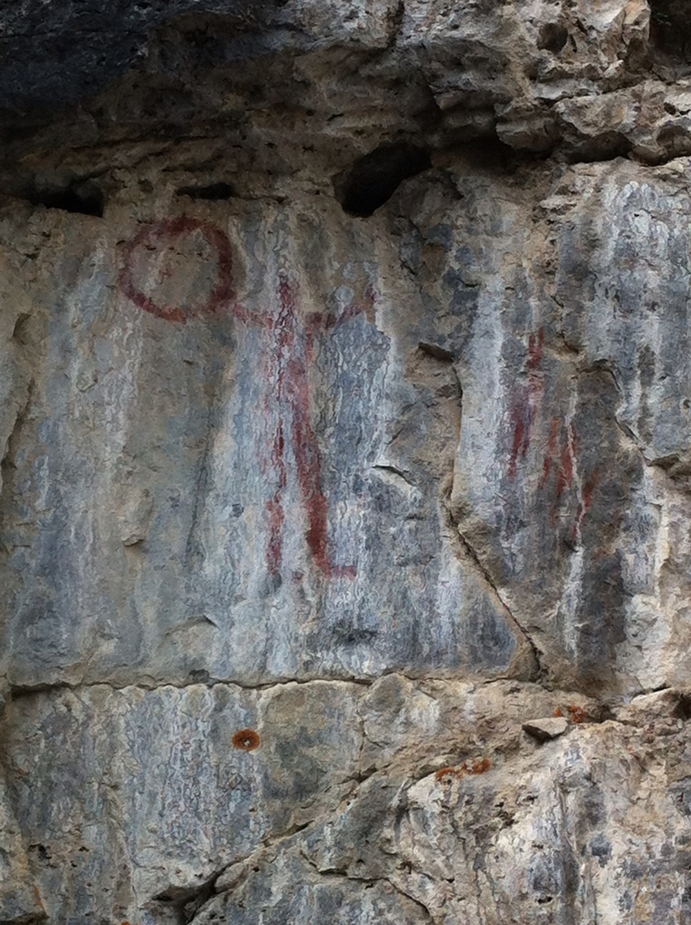 This is the better of the two petroglyph images.  There was lots of speculation about how it got there and who did it by the people looking at it.  To me it looks like a drum dancer.