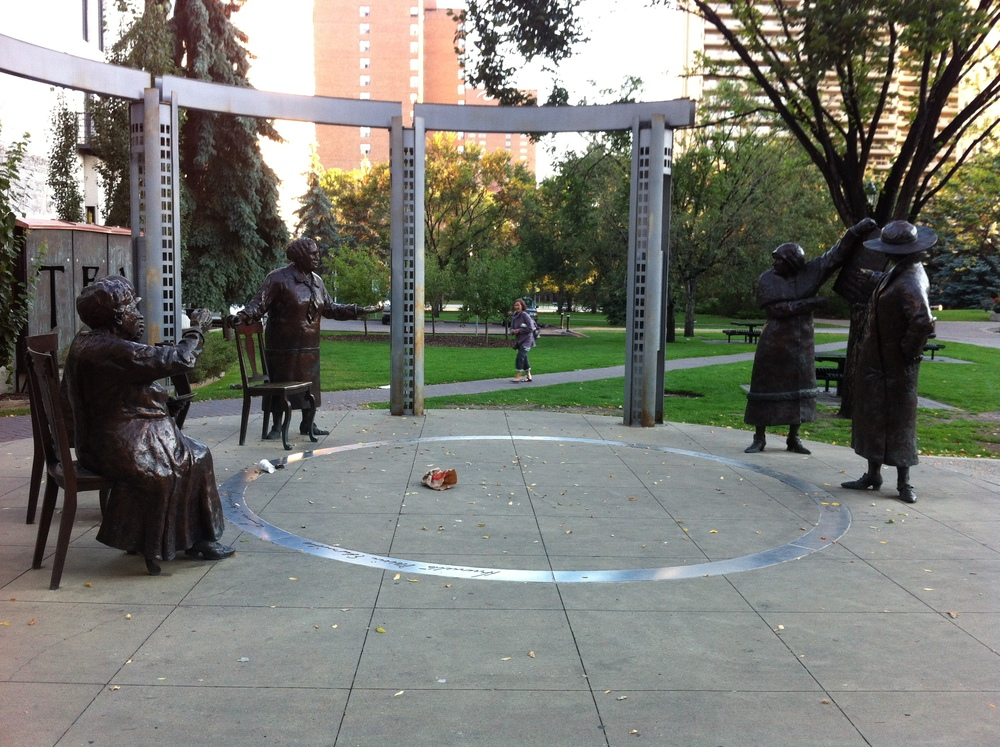 This is the Famous 5 sculpture by Edmonton sculptor Barbara Paterson in Calgary's Olympic Plaza.  Paterson captured the five women at the moment they reunited over a cup of tea to celebrate their victory.