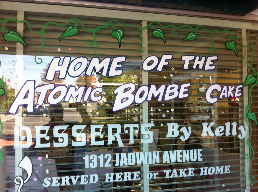 "We decided to check what else was in the plaza and just a few door around the corner was the sign ""Desserts by Kelly"" with the Atomic Bombe cake.  Who could resist checking this out. Once inside we found the strangest shop.  The front had framing and art supplies, another wall was all baseball collectables and then at the back was the bakery with wonderful looking cakes, cookies, scones and of course the Atomic Bombe cadke."