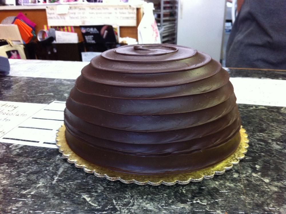 This is the Atomic Bombe Cake with layers of velvety chocolate mousse, pralines and chocolate truffle icing.  It retails for $28.95 and they sell at least 4 per day.  I was sooooooo tempted.