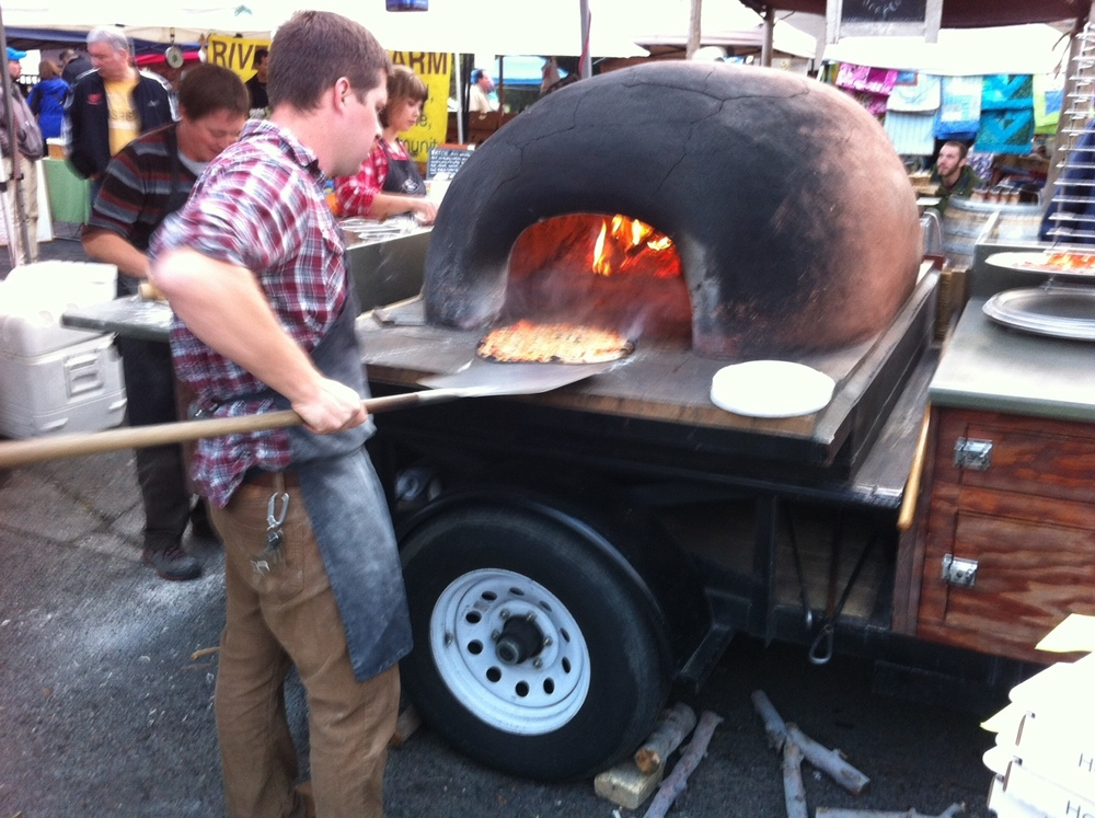 One of the anchor vendors at the market is guy with the portable pizza oven.  By looks of the line up to buy pizza it is very good. Many people where grabbing a pizza and heading home after shopping the market.