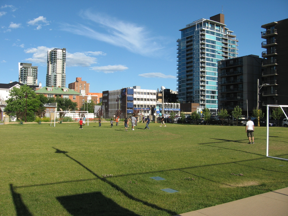 Haultain Park in the Beltline is a busy place with a very active playground and sports field.  Old and new condos surround the park.