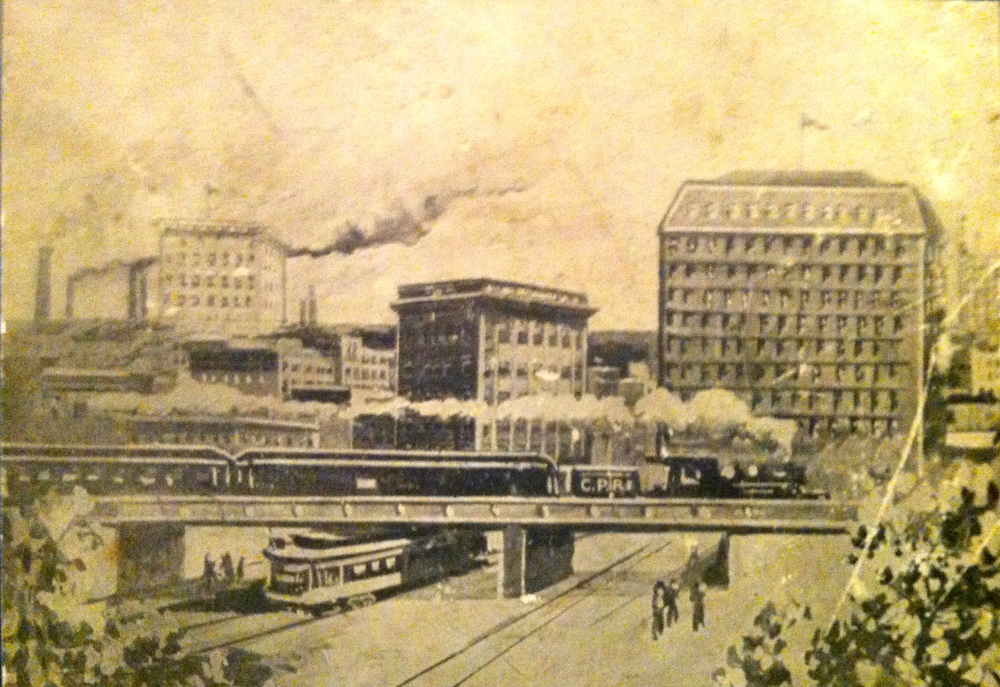 Cover photograph shows downtown Calgary in 1912 as a bustling place with street car, passenger train, smoke stakes and high-rises.