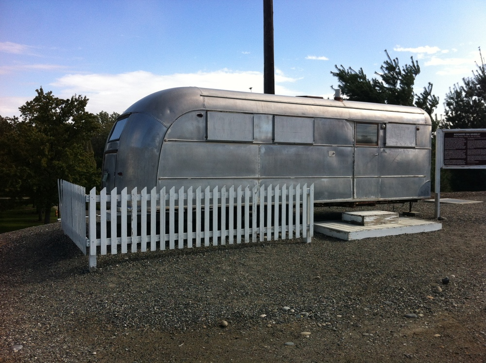 "Saw this intriguing looking trailer with a white picket fence parked on the edge of parking lot and thought we have to investigate.  Sign said ""Boomer on Wheels."" see next photo"