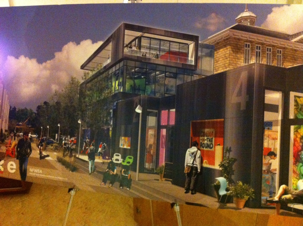 The future of the school? An artist's rendering of the streetscape to be created with the school hidden in the background.  I hope that the old and the new can be integrated in a synergistic fashion that will capture the public's imagination.