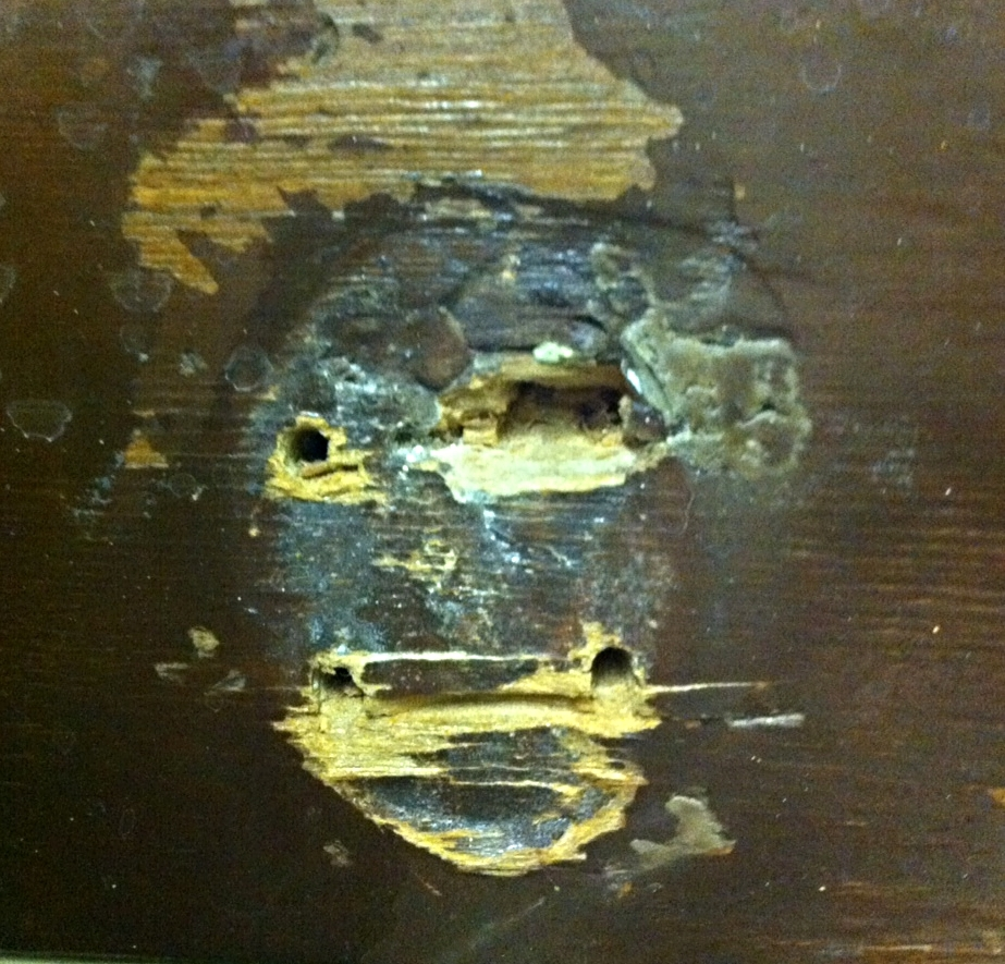 African mask? Monkey mask? Found several of these along a piece of wood that use to have coat hangers on it.