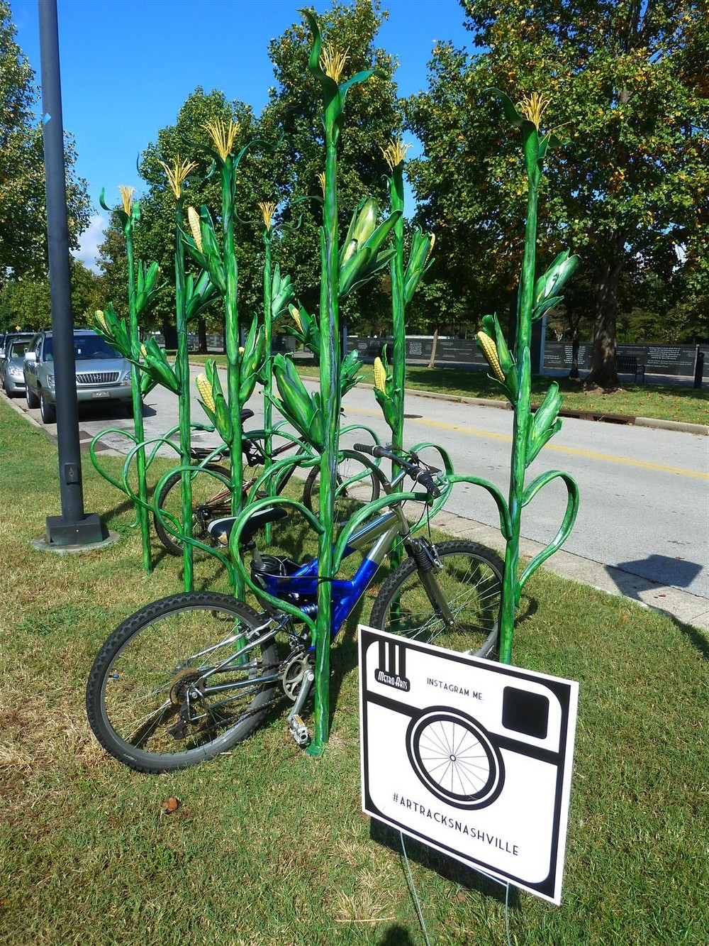 "This quirky corn stalk bike rack on a quiet residential street are a good example of ""urban surprise.""  Credit: L. Olfert"