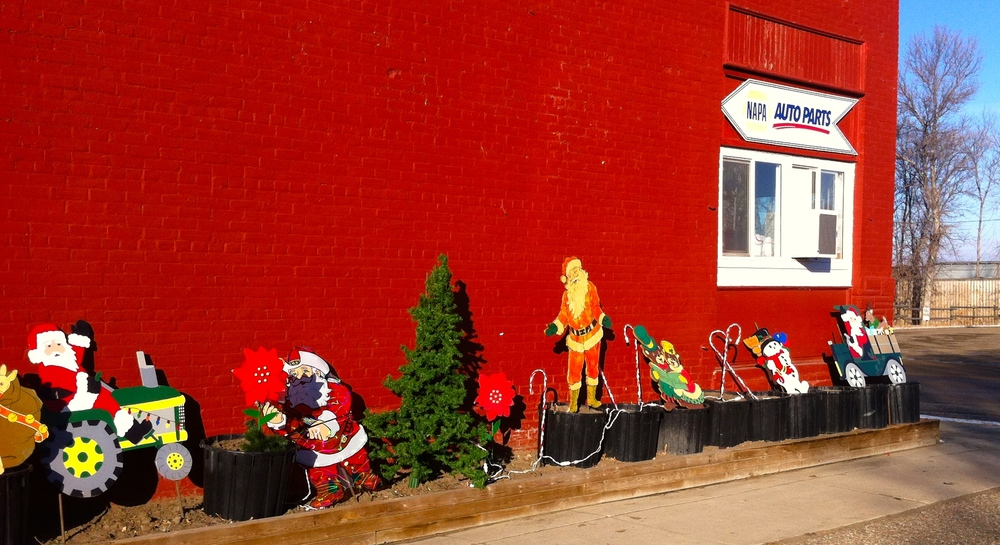 Found these fun lawn ornaments lined up on the wall outside the Maple Creek thrift store.  We had to stop and check it out.