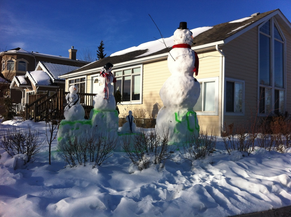 This could be the tallest snowman I have ever seen over 15 feet.  Somebody in Calgary was embracing winter. The park across the street from our house now has 3 snowman.