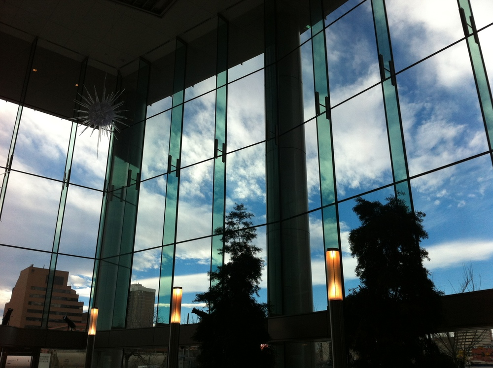 The lobby offers dramatic views of Calgary southern sky.