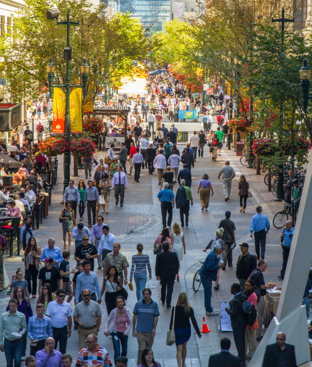 Calgary's GABEsters take over Stephen Avenue Walk at lunch hour to stroll the street, grab some lunch or people watch. Photo Credit: Jeff Trost