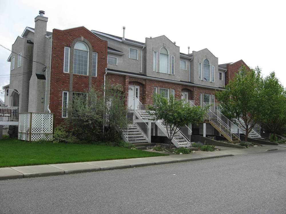 Example of new infill developments that fit into established neighbourhoods with mid-20th century home. Use of brick, recessed garages and pitched roof is synergistic with existing homes.