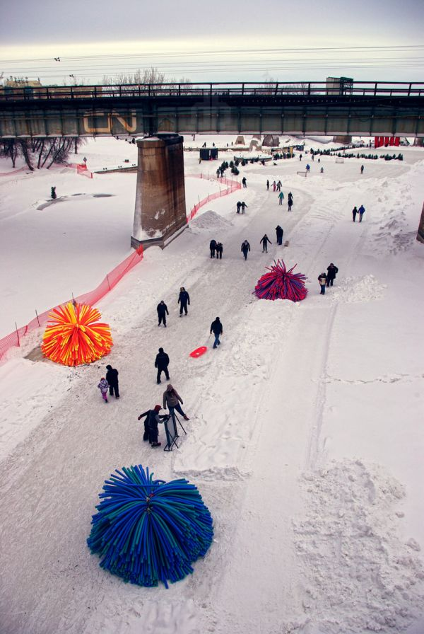 "Winnipeg boast the longest skating rink in the world along their rivers. The colourful ""pom poms"" called ""Nuzzels"" are actually warming huts on the Assiniboine River - they add fun, colour, charm and functionality. (Photo credit: Raw Design)."