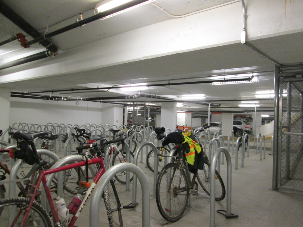 Eight Avenue Place offers its tenant over 300 bike parking stalls, with adjacent showers, lockers and a private ramp and access card control.  More and more the city is requiring developers to provide bike parking, which means we need to provide more cycling friendly streets to major new office developments.