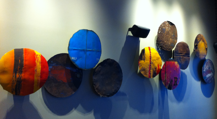 Old metal drums lids have been transformed into FFQ artwork at Red's in Ramsay.