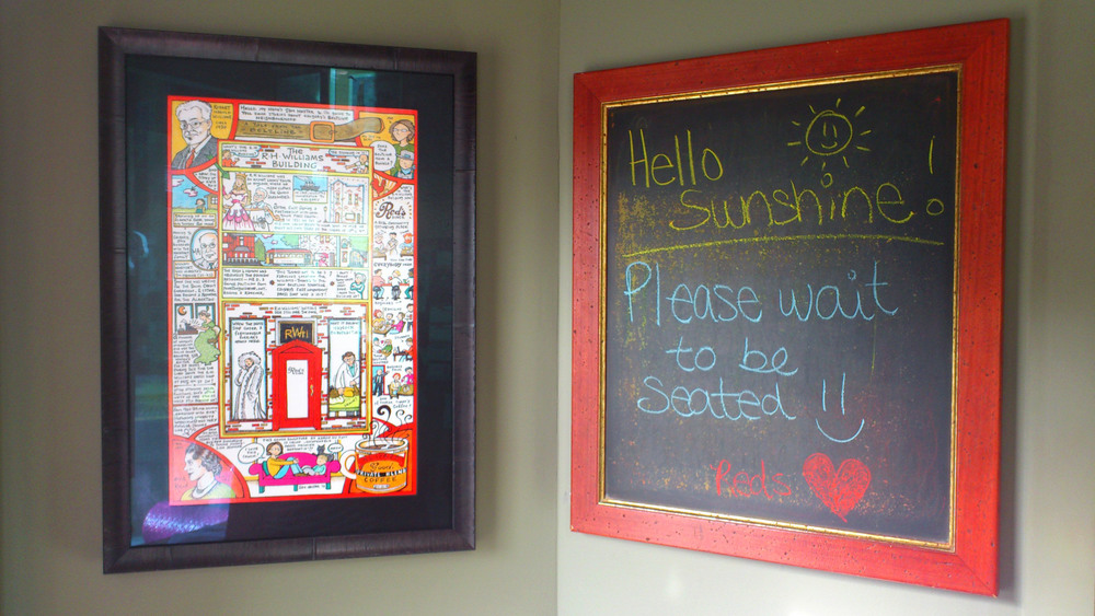 Sam Hester has been adopted by Red's as their local artist, commissioning artworks for both locations.  Hester's fun and colourful visual stories makes for a fun and quirky entrance at Red's in Ramsay.