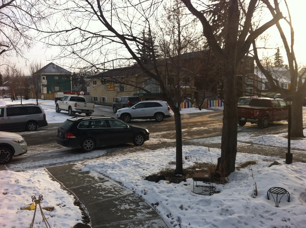 Starting about 7 am and 4 pm the cars arrive for the Daycare Ballet. You can see the white truck is parked on the berm of the park, the white SUV is backing into the spot in front of the daycare. While another SUV is parking in front of our house.