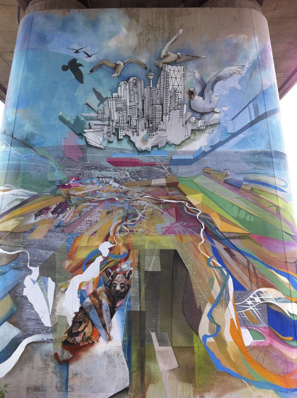 """The Field Manual: A compendium of local influence,"" by Light & Soul (Daniel j. Kirk, Ivan Ostapenko and Kai Cabunoc-Boettcher) consists of several murals along the River Walk in Calgary's East Village.  This is a temporary installation that was completed in the summer of 2013 and will remain for 24 months."