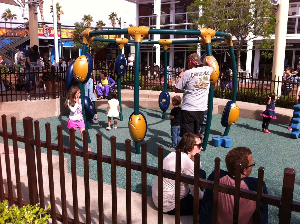 Children enjoying the playground at Container Park during the day.