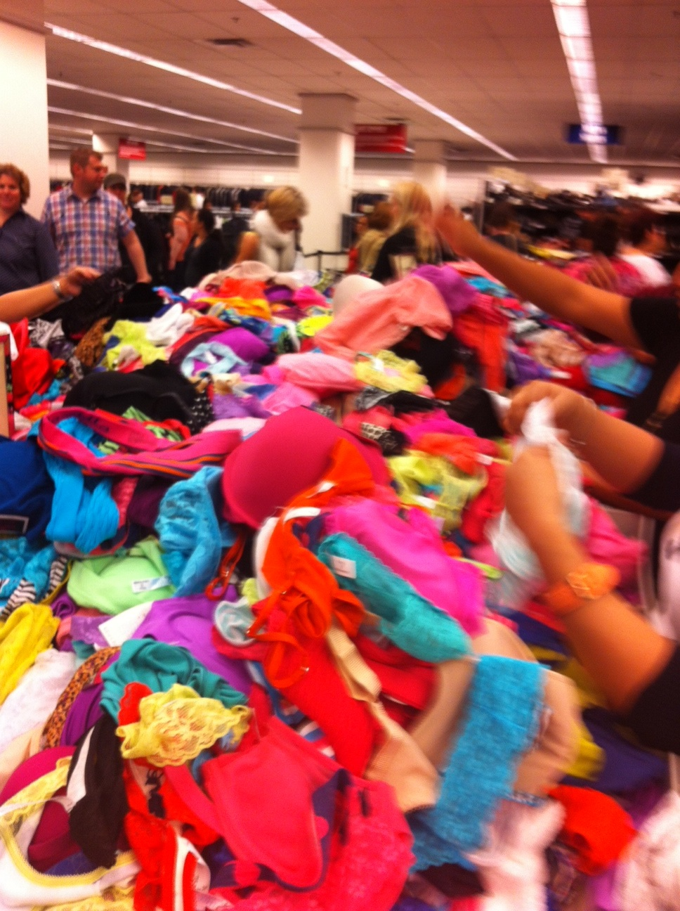 However, once inside you are immediately confronted with a frenzy of shoppers like those sifting through a huge bin of colourful women's underwear.