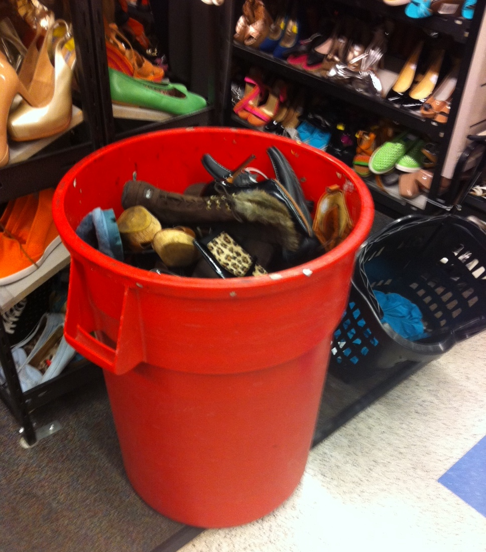 Red trash barrels are strategically placed in the shoe department so staff can just throw in shoes for sorting and restocking later.
