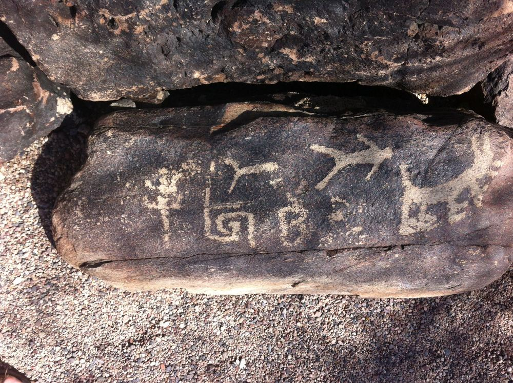 This is the petroglyph rock that Wright found on his property and had moved to Taliesin West.  He adopted the icon second from the left as his logo.