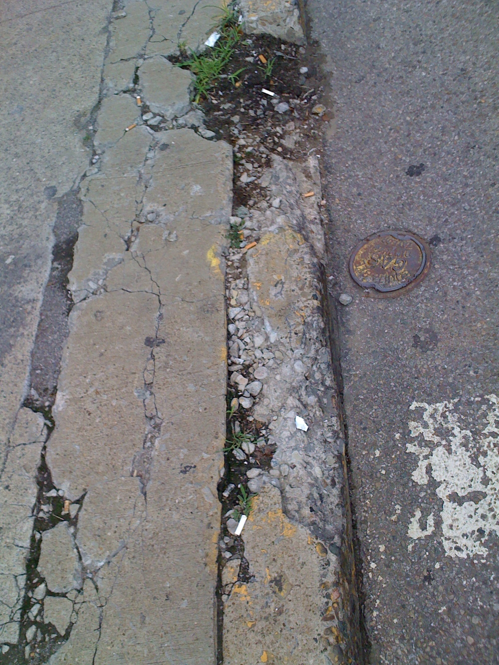 Broken curbs and sidewalks don't make of a pleasant walking experience.