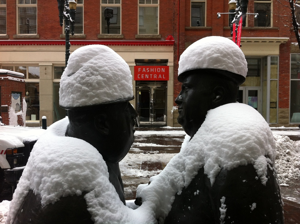 "William McElcheran's ""Conversation"" on Stephen Avenue Walk is very popular with the public.  Often people will place a coffee cup in their hand or add a scarf to one of the figures.  The public loves to have their picture taken with the two businessmen."