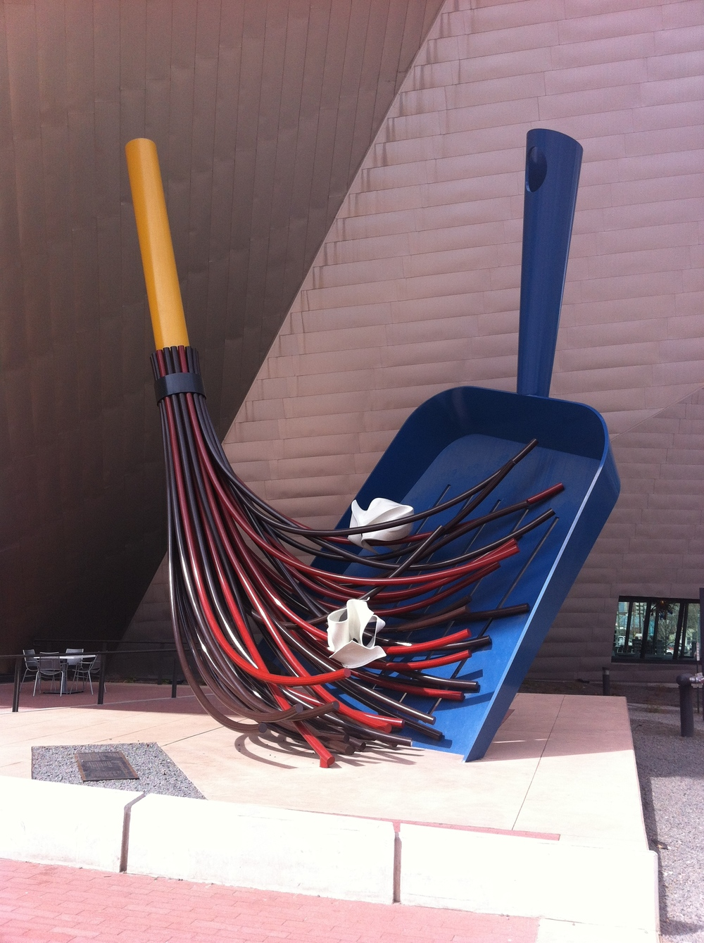 "Claus Oldenburg and Coosjevan Bruggen's ""Big Sweep"" sits outside the entrance to the Denver Art Museum. It is fun, but static, and there is signage next to it with several rules that restrict how you can interact with it."