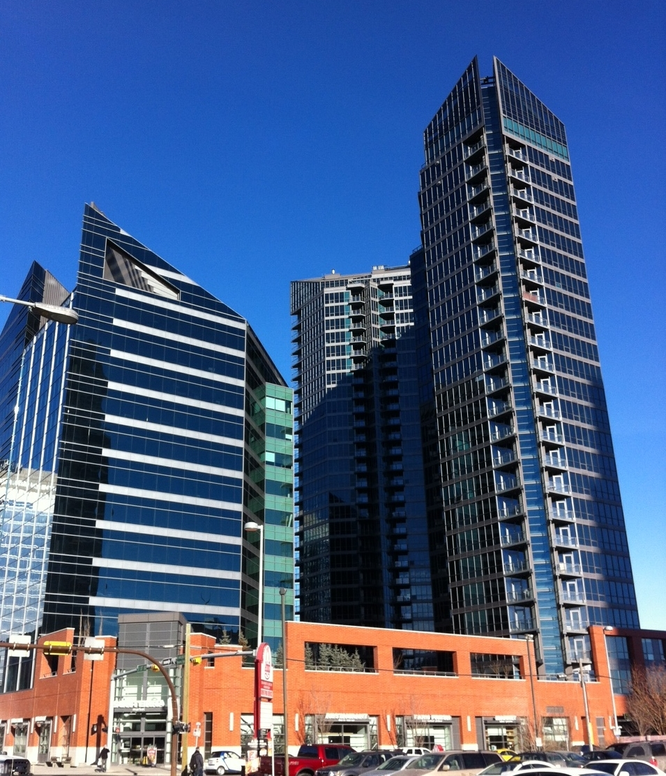 Mixed-use development in downtown Calgary includes major office and condo towers with urban grocery store.
