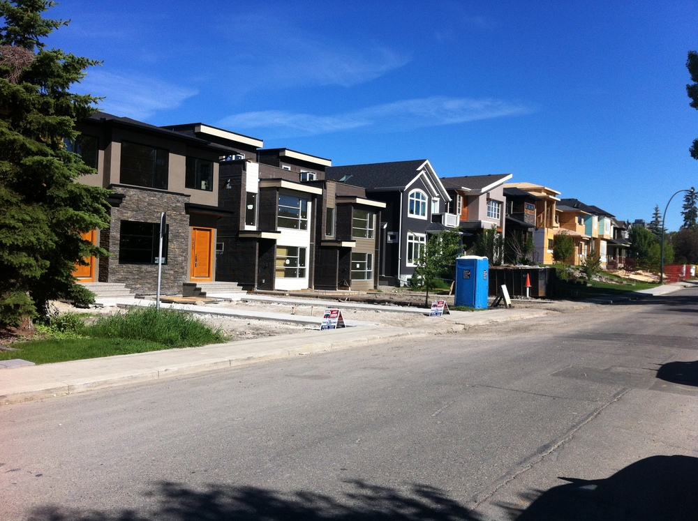 A parade of new infill homes in West Hillhurst.