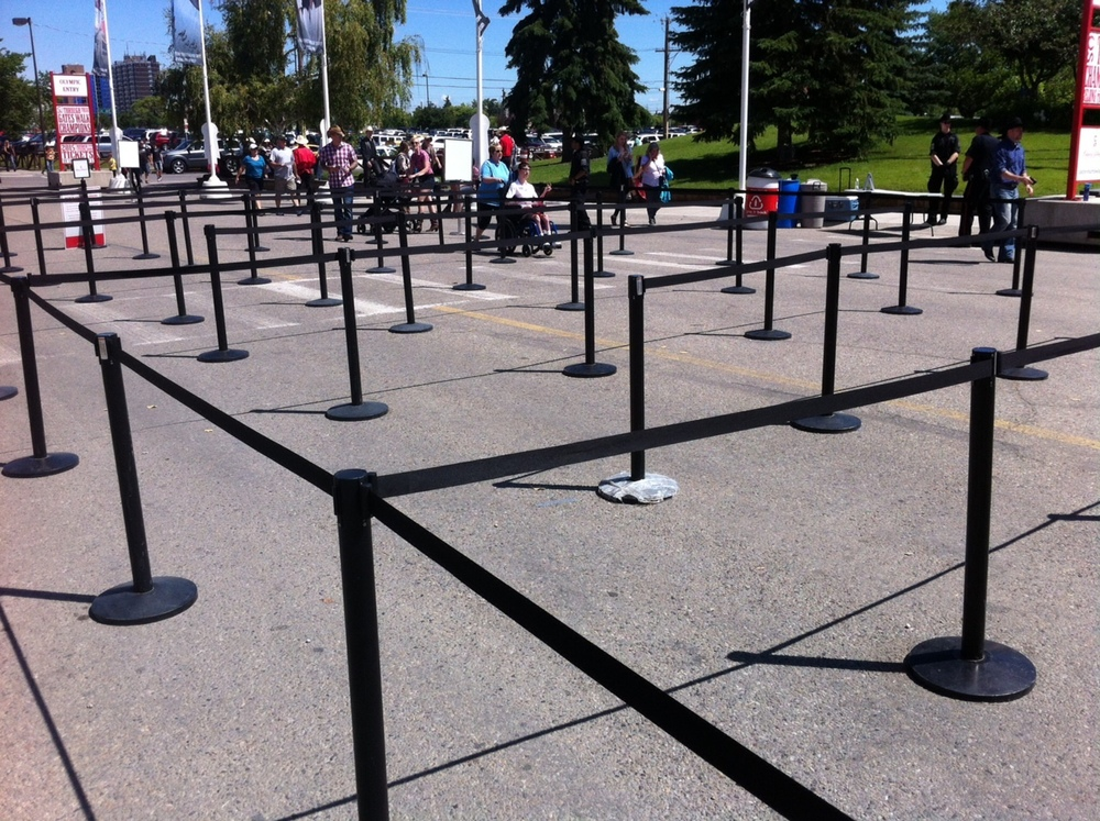 Corrals herd the people to the north entrance of Stampede Park.